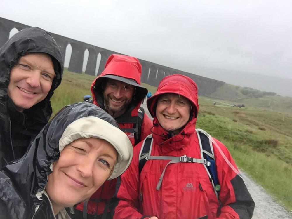 Members of the Spencer Group More Together team reach Ribblehead Viaduct during the Yorkshire Three Peaks challenge.